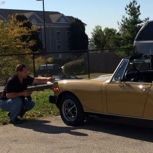 Steven Paul the owner of Test Drive Technologies performing a pre-purchase classic car inspection on a MG